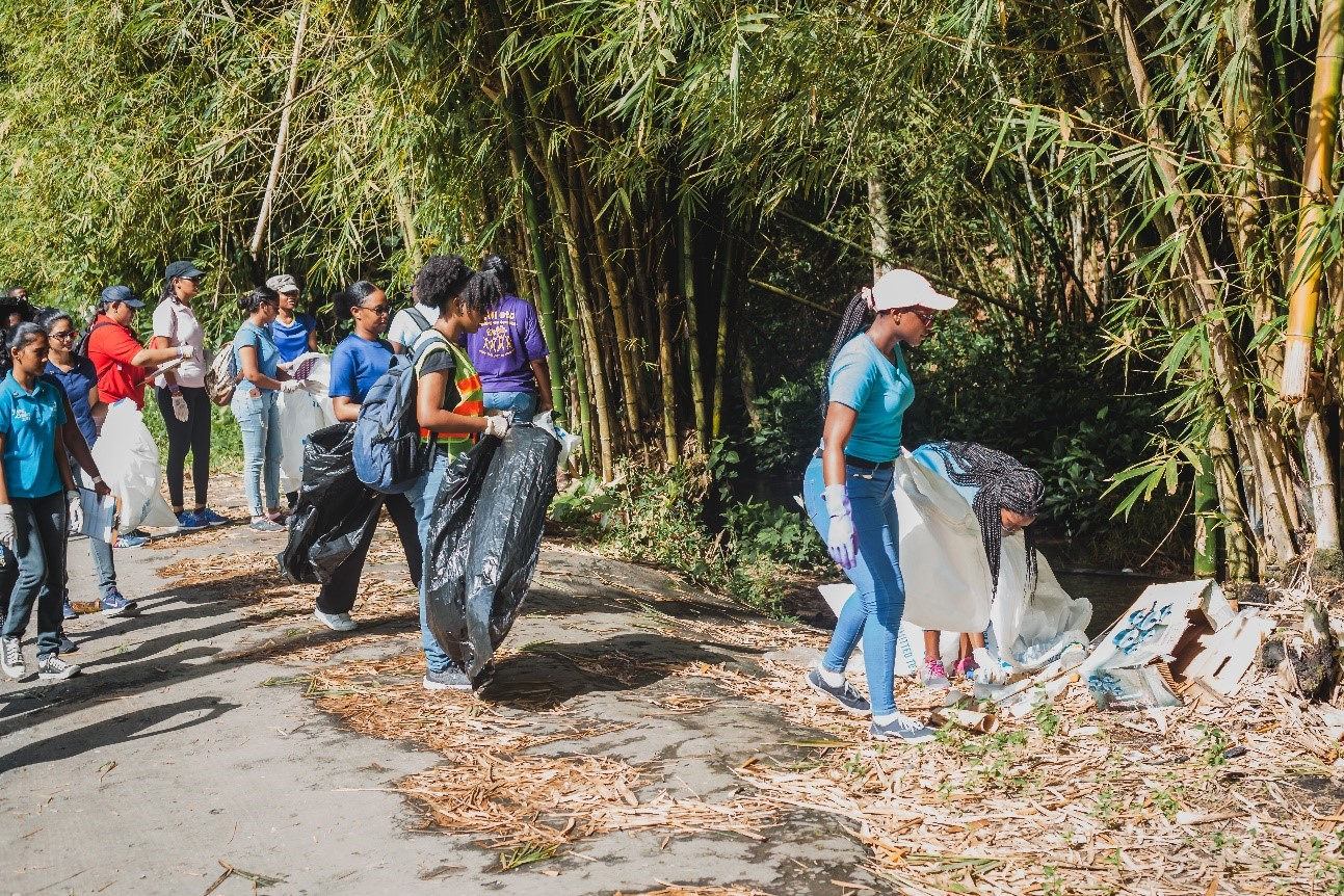 Corporate Partners help UWI First Years tackle Caura Clean-up